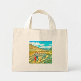 Women on a tocky mountain stream mini tote bag