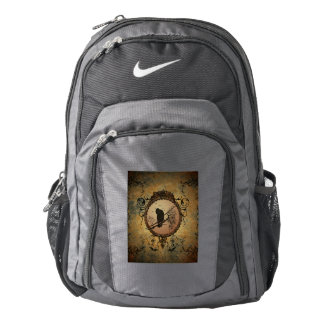 Wonderful bird in a circle made of rusty metal backpack