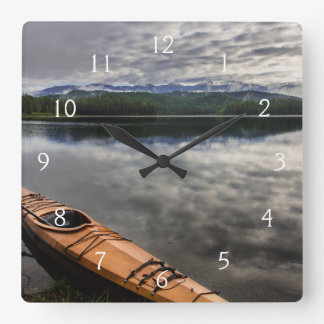 Wooden kayak on shore of Beaver Lake Square Wall Clock