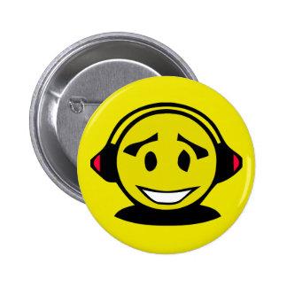 Yellow smiley face wearing headphones 6 cm round badge