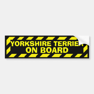 Yorkshire Terrier on board yellow caution sticker