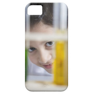 Young boy in chemistry science class, looking iPhone 5 cover