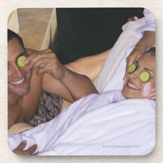 Young couple enjoying a spa treatment. drink coasters