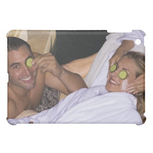 Young couple enjoying a spa treatment. case for the iPad mini