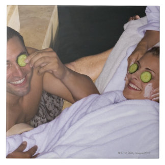 Young couple enjoying a spa treatment. large square tile