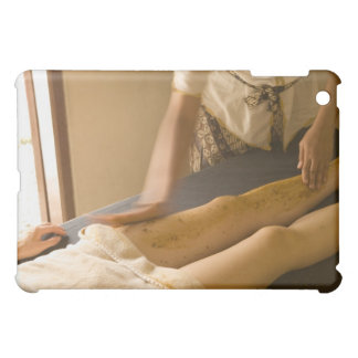 Young woman having leg massage case for the iPad mini