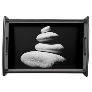 zen stones isolated on white background serving tray